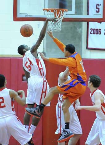 Leonel Hyatt # 54 of Greenwich blocks the shot of Marquise Marrero # 11 of Danbury during the boys high school basketball game between Greenwich High School and Danbury High School at Greenwich, Wednesday, Feb. 20, 2013. Photo: Bob Luckey / Greenwich Time