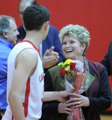 Debbie Guise smiles after receiving flowers from her son Danny Guise, left, during Senior Night at the start of the boys high school basketball game between Greenwich High School and Danbury High School at Greenwich, Wednesday, Feb. 20, 2013. Photo: Bob Luckey / Greenwich Time