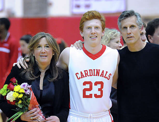 Jake Tennebaum, center, with parents Jodi and David Tennenbaum during Senior Night at the start of the boys high school basketball game between Greenwich High School and Danbury High School at Greenwich, Wednesday, Feb. 20, 2013. Photo: Bob Luckey / Greenwich Time