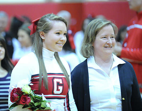 Greenwich senior cheerleader Erin Andrews, left, with her mother, Barbara Ward, during the boys high school basketball game between Greenwich High School and Danbury High School at Greenwich, Wednesday, Feb. 20, 2013. Senior GHS cheerleaders were honored at the start of the game. Photo: Bob Luckey / Greenwich Time