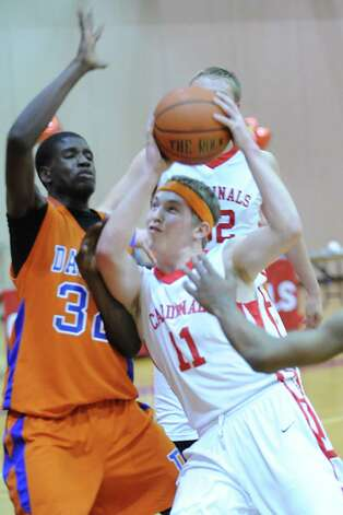 At right, Alex McMurray # 11 of Greenwich drives to the basket while being covered by Danbury's Jalen McCallum # 32 during the boys high school basketball game between Greenwich High School and Danbury High School at Greenwich, Wednesday, Feb. 20, 2013. Photo: Bob Luckey / Greenwich Time