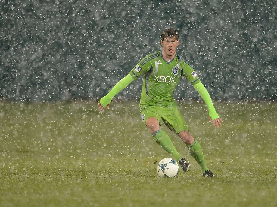 TUCSON, AZ - FEBRUARY 20:  Brad Evans #3 of the Seattle Sounders brings the ball up field in a snow storm against the New York Red Bulls at Kino Sports Complex on February 20, 2013 in Tucson, Arizona.  (Photo by Norm Hall/Getty Images) Photo: Norm Hall, Getty Images