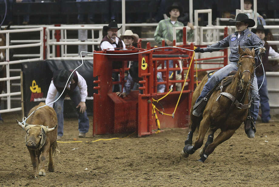 Team roping header Kaleb Driggers, of Albany, Ga., who's had plenty of success in the San Antonio Stock Show & Rodeo, misses an attempt here, but his team, including heeler Kinney Harrell of Marshall, advances to Saturday night's finals competition. Photo: Jerry Lara / San Antonio Express-News