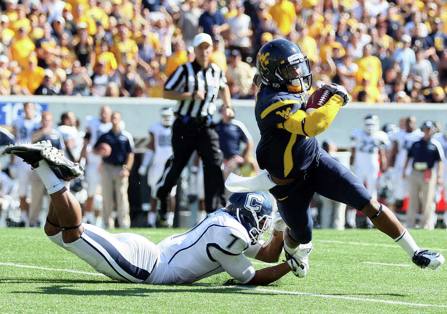9. Tavon Austin, WR, West VirginiaNeeds to run incredibly fast to compensate for lack of size, but he may be the most versatile player in the draft. Photo: Chris Jackson