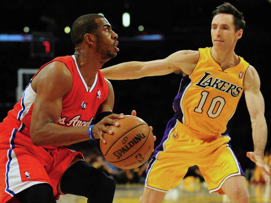 The Clippers' Chris Paul (left), guarded by the Lakers' Steve Nash, has returned from injury and is an MVP candidate. Photo: Frederic J. Brown / Getty Images
