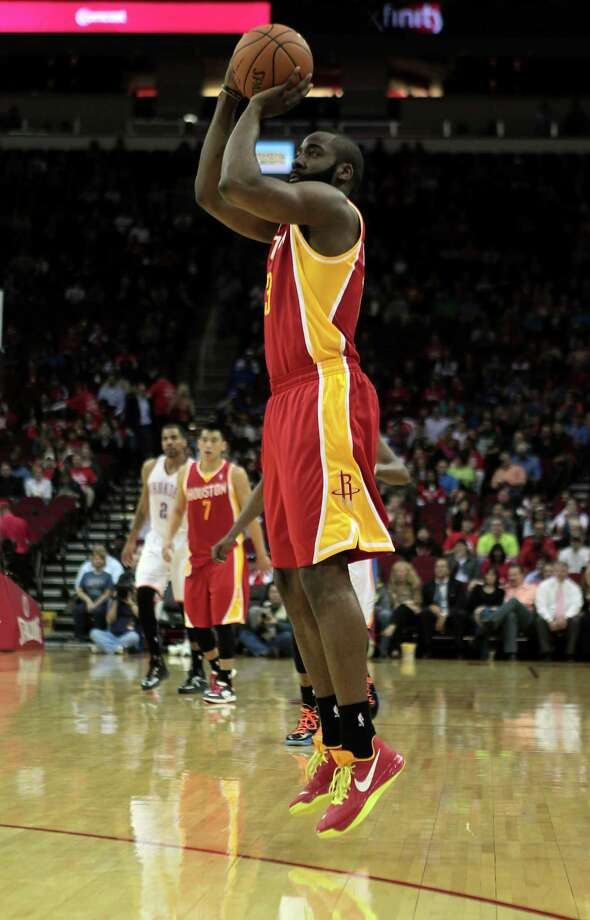 James Harden sinks a 3-pointer in the fourth quarter on a night when he was 7-of-8 from long range. He burned his former team for 46 points while attempting just 19 shots from the field. Photo: James Nielsen, Staff / © 2013  Houston Chronicle
