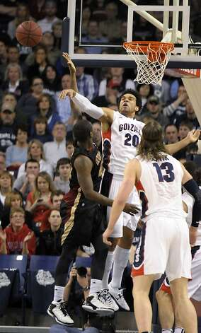 Gonzaga's Elias Harris (20) blocks Santa Clara's Kevin Foster in the first half of the Bulldogs' home victory. Photo: Jed Conklin, Associated Press