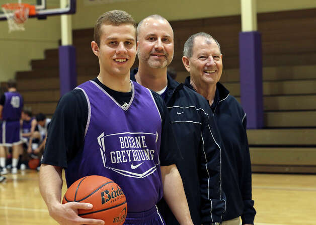Boerne point guard Griffin McHone is backed up by his father Kimble McHone and his grandfather Morris as they trio hang out before practice in the Boerne High School gym on February 20, 2013. Photo: TOM REEL, San Antonio Express-News