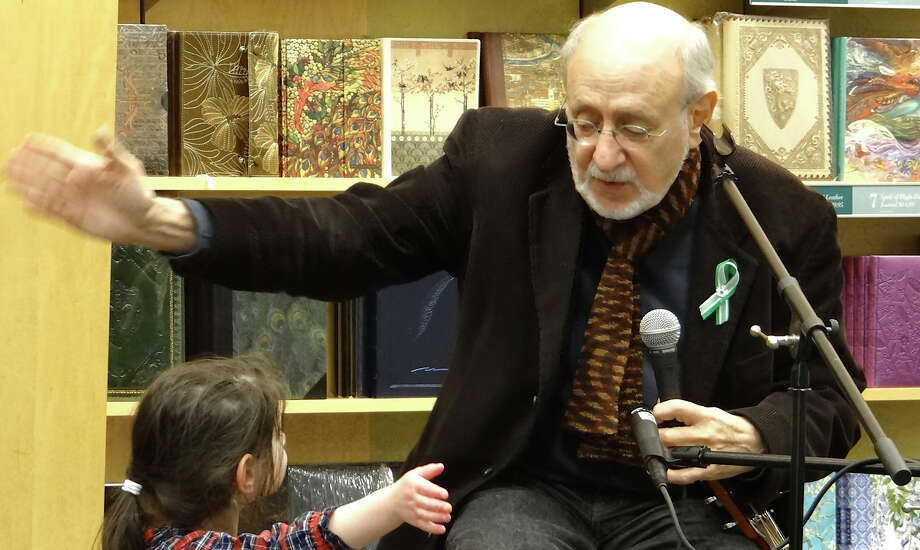 Singer-songwriter Peter Yarrow helps lead 3-year-old Emae Forman in a sing-along Wednesday night the at Barnes & Noble book store.   WESTPORT NEWS, CT 2/20/13 Photo: Mike Lauterborn / Westport News contributed