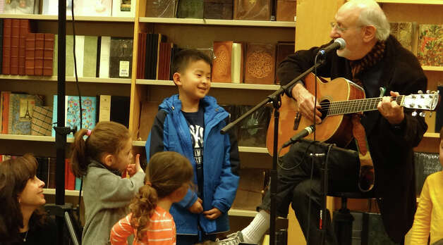 "Children gather around singer-songwriter Peter Yarrow as he sings ""Puff the Magic Dragon"" at the Barnes & Noble book store Wednesday evening. Photo: Mike Lauterborn / Westport News contributed"