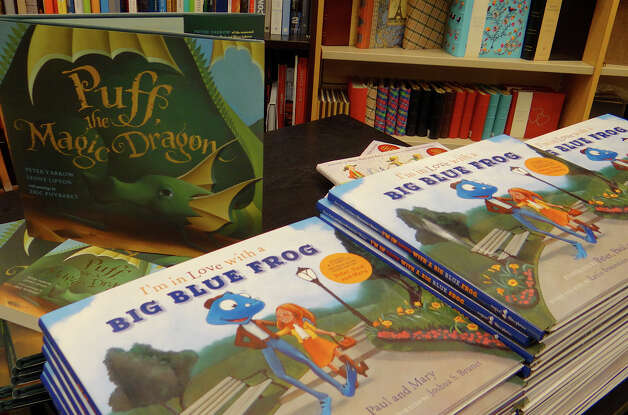 "Copies of Peter Yarrow's new book, ""I'm in Love with a Big Blue Frog,"" along with the earlier, ""Puff, the Magic Dragon,"" stacked on a table at Barnes & Noble book store Wednesday.  WESTPORT NEWS, CT 2/20/13 Photo: Mike Lauterborn / Westport News contributed"