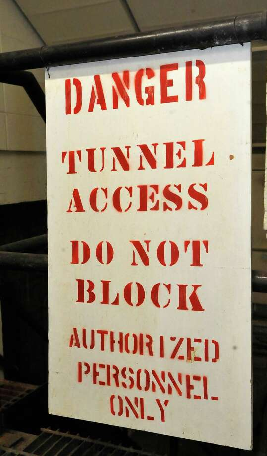 "As we moved downward, the signs started to appear.  The tunnel's entrances around campus are locked and inside the tunnels are motion sensors and cameras that are monitored at the Physical Plants.   Stories about these tunnels can be heard involving ""Tunnel Rats,"" students who knew how to get into the tunnels and use them. Some stories are about fraternities using them for initiation tests to join the frat. My ""official"" guide for this excursion was Gerald McCaig, Interim Associate Vice President of Facilities Management, who took me down to the lower basement level of the Mary and John Gray Library to show me the first tunnel entrance. Every town has them, known as ""secret places,"" and they are usually off limits to the general public. You may have heard of them, wondered about them, but have never seen them, or you may not realize they exist at all.  One such place is one of the two Physical Plants at Lamar University and the heating, cooling, and electrical conduits that run from it through a tunnel system to every building on campus. I was not allowed to go into any of the tunnels due to several restrictions and lack of confined space training, but I was shown several entrances to them.      Dave Ryan/The Enterprise"