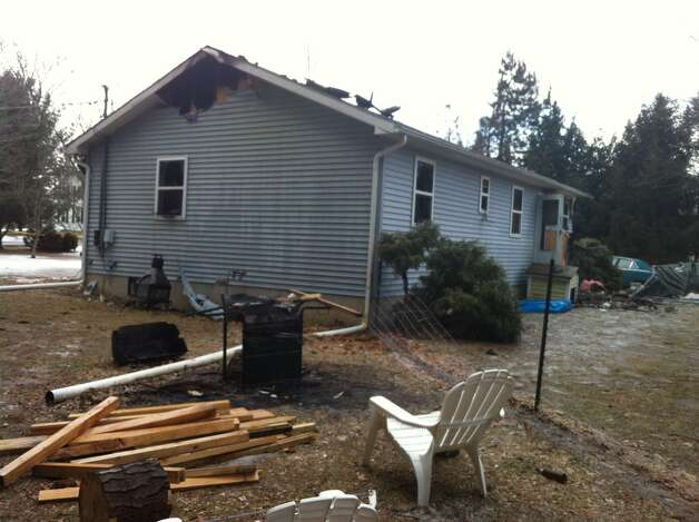 A 61-year-old man died in a house fire on Glenmont Road, police confirmed Thursday morning. Brad Woodworth was found in the bathroom at 173 Glenmont Road. He was pronounced dead at Albany Medical Center Hospital after the fire was reported at 10:12 p.m. Wednesday. (Kristen Brown / Times Union)