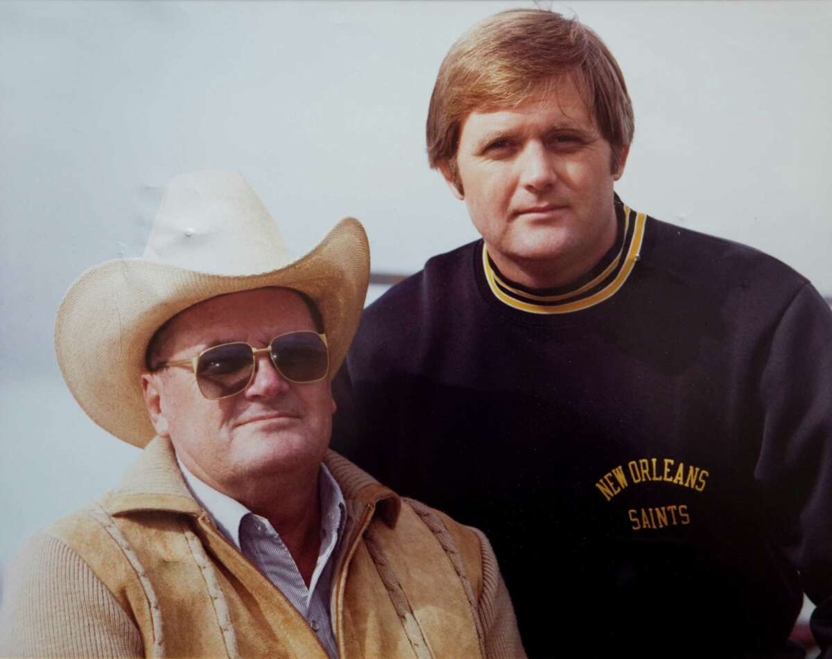 """Former Houston Oilers head coach O.A. """"Bum"""" Phillips is shown with his son, Dallas Cowboys head coach Wade Phillips in a 1981 photo that hangs on the wall at his ranch copied Tuesday, Sept. 21, 2010, in Goliad."""