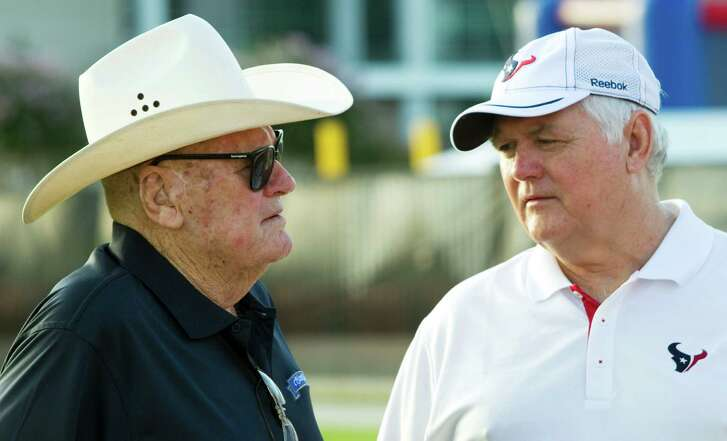 Former Houston Oilers head coach Bum Phillips, left, visits with his son, Houston Texans defensive coordinator Wade Phillips, before practice at Texans training camp at the Methodist Training Center Wednesday, Aug. 3, 2011, in Houston.