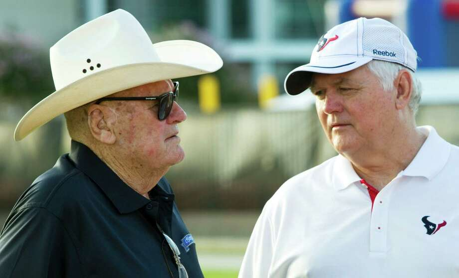 Wade Phillips, right, learned from working under his father, the legendary Bum Phillips.Click through the gallery for more photos of Wade Phillips through the years. Photo: Brett Coomer, Houston Chronicle / © 2010 Houston Chronicle