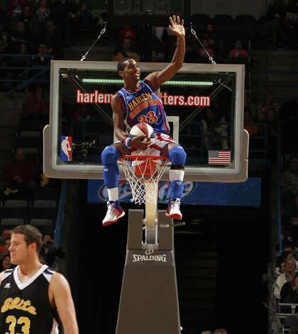 Bull Bullard finds himself above the action during a recent Harlem Globetrotters game. The team will be making a stop in Bridgeport, Conn., Friday, Feb. 22, 2013, at the Webster Bank Arena for a 7 p.m. game. For more information, or to purchase tickets, call 800-745-3000 or visit http://www.ticketmaster.com. Photo: Contributed Photo