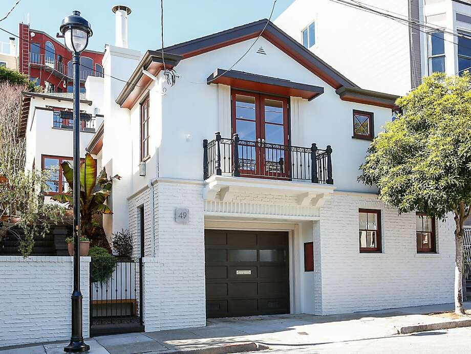 This Spanish Mediterranean home in Ashbury Heights is available for $2.75 million. Photo: Adam Willis Photography