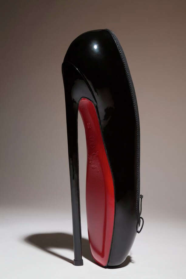 "In this undated photo provided by the Fashion Institute of Technology shows Christian Louboutin's ""Fetish Ballerine"" pump. The shoe is on display at the ""Shoe Obsession"" exhibit at The Museum at the Fashion Institute of Technology Museum in New York. The exhibition, showing off 153 specimens, runs through April 13. Photo: AP / Fashion Institute of Technology"