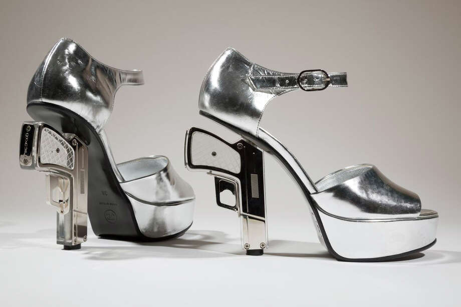 "In this undated photo provided by the Fashion Institute of Technology shows a pair of silver shoes designed by Chanel with guns as heels. The shoe is on display at the ""Shoe Obsession"" exhibit at The Museum at the Fashion Institute of Technology Museum in New York. The exhibition, showing off 153 specimens, runs through April 13. Photo: AP / Fashion Institute of Technology"
