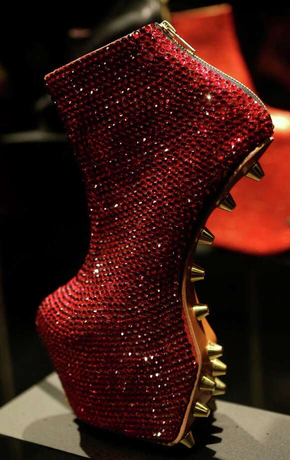 "This Feb. 11, 2013 photo shows an avant-garde, sequined platform heel designed by Noritaka Tatehana displayed at the ""Shoe Obsession"" exhibit at The Museum at the Fashion Institute of Technology Museum in New York. The exhibition, showing off 153 specimens, runs through April 13. Photo: Kathy Willens, AP / AP"