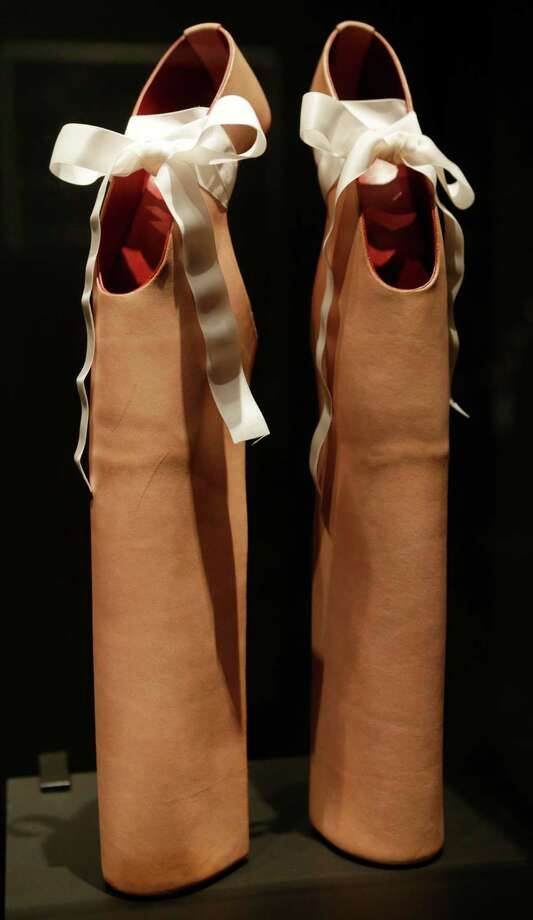 "This Feb. 11, 2013 photo shows a pair of shoes designed by Noritake Tatehana for Lady Gaga displayed at the ""Shoe Obsession"" exhibit at The Museum at the Fashion Institute of Technology Museum in New York. The exhibition, showing off 153 specimens, runs through April 13. Photo: Kathy Willens, AP / AP"