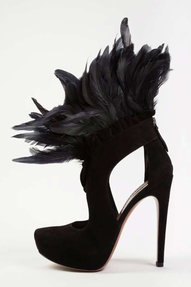 "In this undated photo provided by the Fashion Institute of Technology, shows a shoe decorated with feathers and designed by Azzedine Alaia. The shoe is on display at the ""Shoe Obsession"" exhibit at The Museum at the Fashion Institute of Technology Museum in New York. The exhibition, showing off 153 specimens, runs through April 13. Photo: AP / Fashion Institute of Technology"