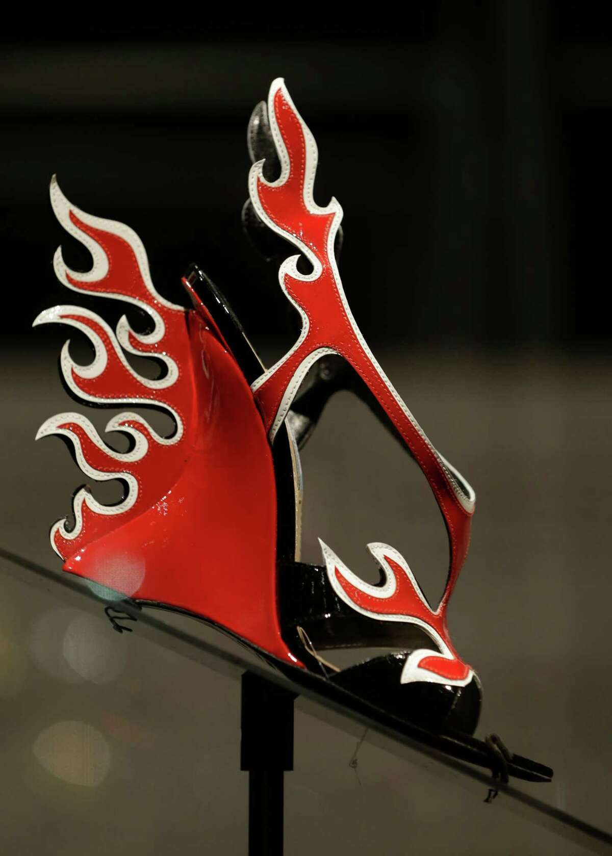 This Feb. 11, 2013 photo shows a red and white patent leather flame Prada sandal displayed at the