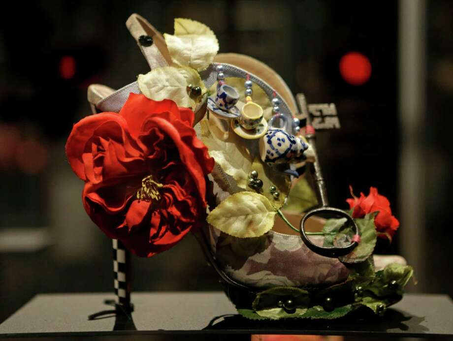 "This Feb. 11, 2013 photo shows a shoe decorated with a miniature tea set and a lock titled ""Alice,"" and designed by Nicholas Kirkwood, on display at the ""Shoe Obsession"" exhibit at The Museum at the Fashion Institute of Technology Museum in New York. The exhibition, showing off 153 specimens, runs through April 13. Photo: Kathy Willens, AP / AP"