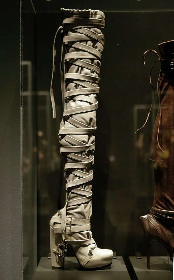 "This Feb. 11, 2013 photo shows a thigh-high boot designed by Nicholas Kirkwood for the Rodarte spring 2009 fashion show at the ""Shoe Obsession"" exhibit at The Museum at the Fashion Institute of Technology Museum in New York. The exhibition, showing off 153 specimens, runs through April 13. Photo: Kathy Willens, AP / AP"