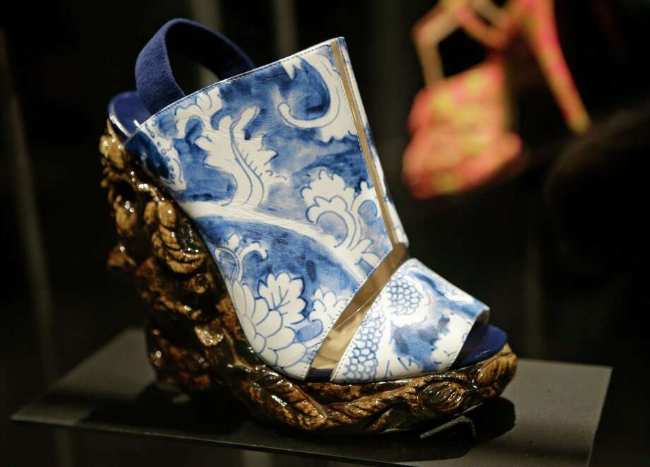 "This Feb. 11, 2013 photo shows a shoe designed by Nicholas Kirkwood for the Rodarte spring 2011 fashion show that has the appearance of antique ceramic ware is displayed at the ""Shoe Obsession"" exhibit at The Museum at the Fashion Institute of Technology Museum in New York. The exhibition, showing off 153 specimens, runs through April 13. Photo: Kathy Willens, AP / AP"