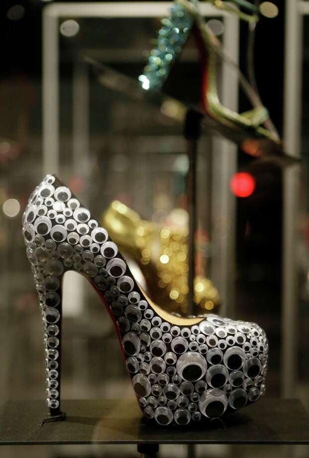 "This Feb. 11, 2013 photo shows a Christian Louboutin's shoe with googly-eye decorations, is displayed at the ""Shoe Obsession"" exhibit at The Museum at the Fashion Institute of Technology Museum in New York. The exhibition, showing off 153 specimens, runs through April 13. Photo: Kathy Willens, AP / AP"