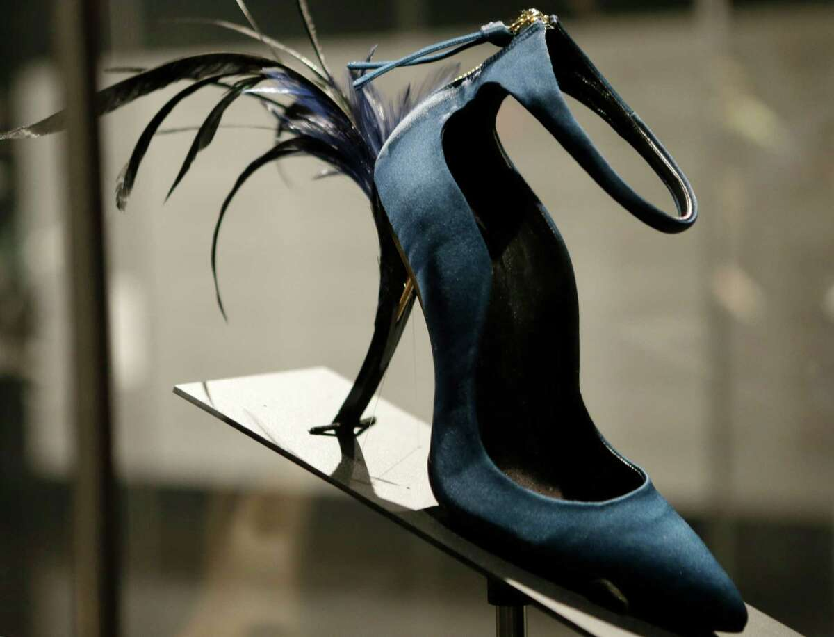 This Feb. 11, 2013 photo shows Roger Vivier's Eyelash Heel pump displayed at the