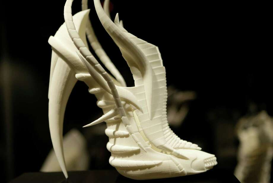 "This Feb. 11, 2013 photo shows Janina Alleyne's ""Exoskeleton"" shoe on display at the ""Shoe Obsession"" exhibit at The Museum at the Fashion Institute of Technology Museum in New York. The exhibition, showing off 153 specimens, runs through April 13. Photo: Kathy Willens, AP / AP"