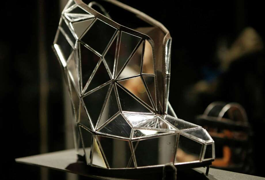 "This Feb. 11, 2013 photo shows a shoe, made of mirror fragments titled ""Invisible"", designed by Andreia Chaves, displayed at the ""Shoe Obsession"" exhibit at The Museum at the Fashion Institute of Technology Museum in New York. The exhibition, showing off 153 specimens, runs through April 13. Photo: Kathy Willens, AP / AP"