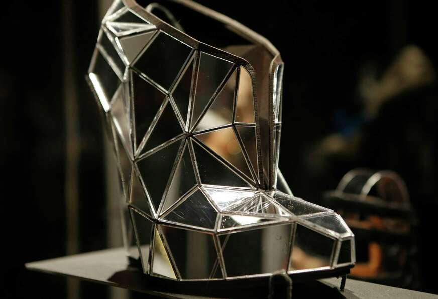 This Feb. 11, 2013 photo shows a shoe, made of mirror fragments titled