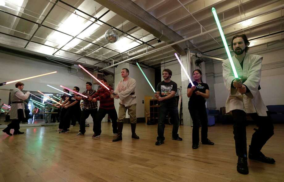 Golden Gate Knights instructor Alain Block, right, teaches during class in San Francisco, Sunday, Feb. 10, 2013. A group of San Francisco Star Wars fans who want to travel to a galaxy not that far away have created a combat choreography class for Jedis-in-training with their weapon of choice: the light saber. Photo: Jeff Chiu, AP / AP