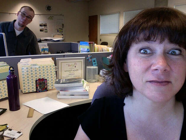 Taking photos at work: There is no good reason to take a photo of yourself at work. Your co-workers are going to snicker and make fun of you for doing it.  (Photo: Emdot, Flickr)