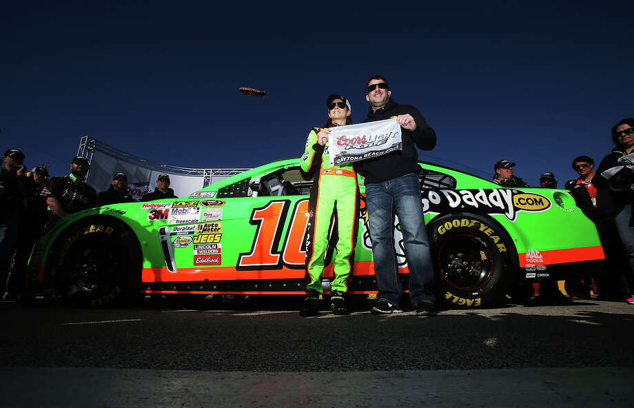 Danica Patrick, driver of the #10 GoDaddy.com Chevrolet, poses with team owner Tony Stewart holding the Coors Light Poll Award after qualifying for the NASCAR Sprint Cup Series Daytona 500 at Daytona International Speedway on February 17, 2013. Photo: Jonathan Ferrey, Getty Images / 2013 Getty Images