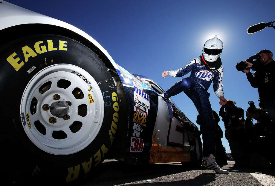 Brad Keselowski, driver of the #2 Miller Lite Ford, gets out of his car after qualifying for the NASCAR Sprint Cup Series Daytona 500 at Daytona International Speedway on February 17, 2013. Photo: Jonathan Ferrey, Getty Images / 2013 Getty Images