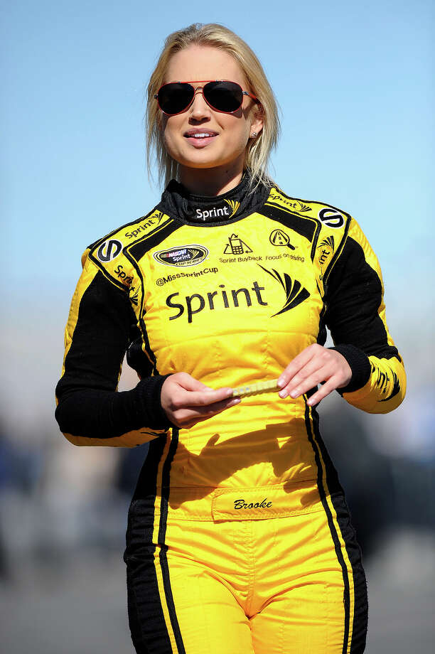 Miss Sprint Cup Brooke Werner walks on the grid during qualifying for the NASCAR Sprint Cup Series Daytona 500 at Daytona International Speedway on February 17, 2013. Photo: Jared C. Tilton, NASCAR Via Getty Images / 2013 NASCAR