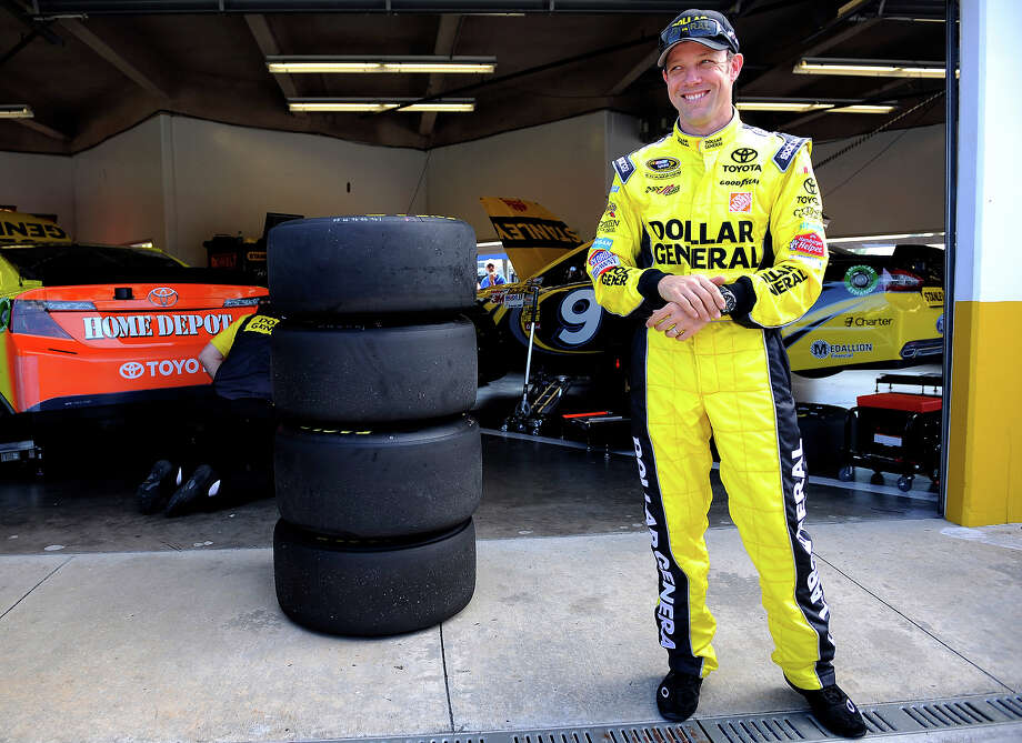 Matt Kenseth, driver of the #20 Dollar General Toyota, stands in the garage area during practice for the NASCAR Sprint Cup Series Daytona 500 at Daytona International Speedway on February 20, 2013. Photo: Jared C. Tilton, NASCAR Via Getty Images / 2013 NASCAR
