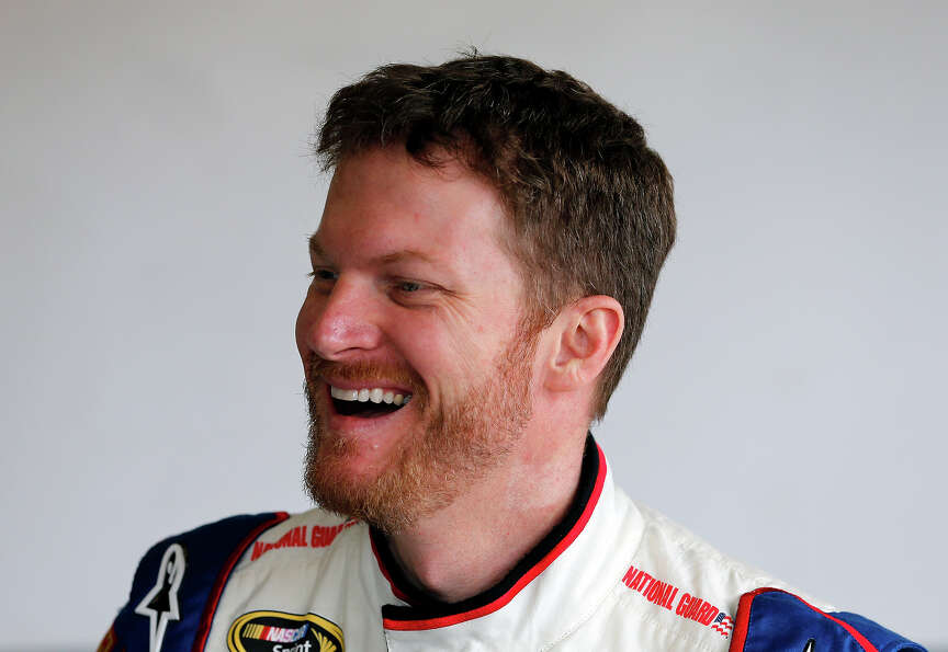 Dale Earnhardt Jr., driver of the #88 National Guard Chevrolet, stands in the garage during practice