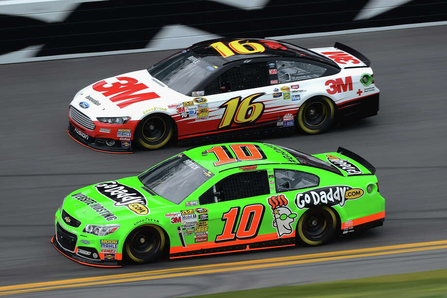 Danica Patrick, driver of the #10 GoDaddy.com Chevrolet, and Greg Biffle, driver of the #16 3M Ford, practice for the NASCAR Sprint Cup Series Daytona 500 at Daytona International Speedway on February 20, 2013. Photo: Jared C. Tilton, NASCAR Via Getty Images / 2013 NASCAR