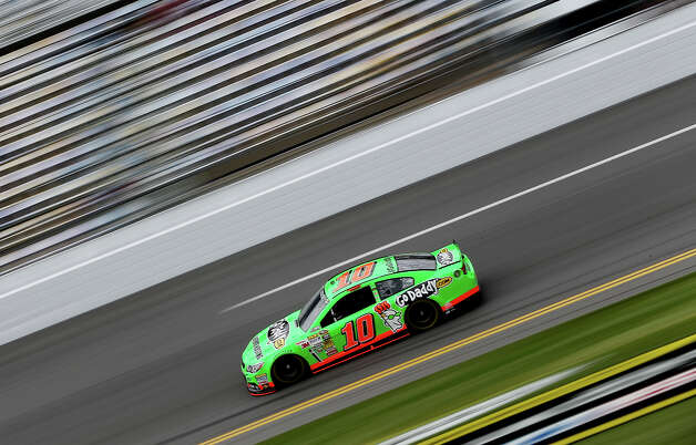 Danica Patrick, driver of the #10 GoDaddy.com Chevrolet, practices for the NASCAR Sprint Cup Series Daytona 500 at Daytona International Speedway on February 20, 2013. Photo: Tom Pennington, NASCAR Via Getty Images / 2013 NASCAR