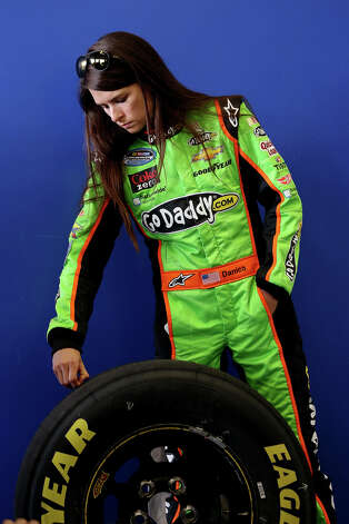 Danica Patrick, driver of the #34 GoDaddy.com Chevrolet, stands in the garage during practice for the NASCAR Nationwide Series DRIVE4COPD 300 at Daytona International Speedway on February 21, 2013. Photo: Tom Pennington, NASCAR Via Getty Images / 2013 NASCAR