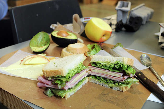 Making lunch: Don't smear that mustard or pile on the turkey at your desk. Make your lunch before you come arrive at the office. (Photo: Svacher, Flickr)