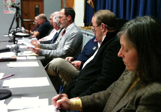 Town officials answer questions at Wednesday public forum concerning repairs and reconstruction in the wake of Superstorm Sandy.  FAIRFIELD CITIZEN, CT 2/20/13 Photo: Andrew Brophy / Fairfield Citizen contributed