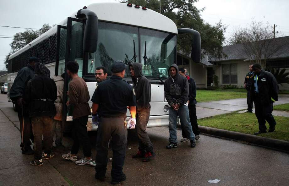 HPD collaborates with ICE to transport 30 undocumented immigrants  to an ICE detention center on Thursday, Feb. 21, 2013, in Houston. ICE received a tip that 30 people were held in a safe house along the 8500 block of Glenaire St. in southeast Houston. Photo: Mayra Beltran, Houston Chronicle / © 2013 Houston Chronicle