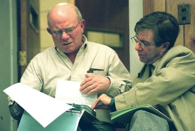 Board of Finance member George McLaughlin and Mayor Bob Gambino share a proposed budget during at New Milford Board of Education budget hearing on Jan. 7, 2002 Photo: Norm Cummings, Norm Cummings/Spectrum / The News-Times